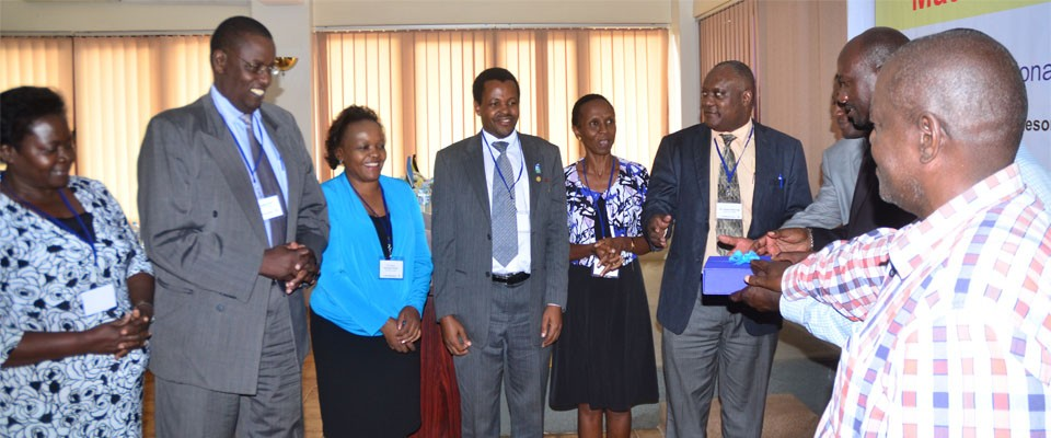 District leaders handing over an award to the Ministry of Health officials